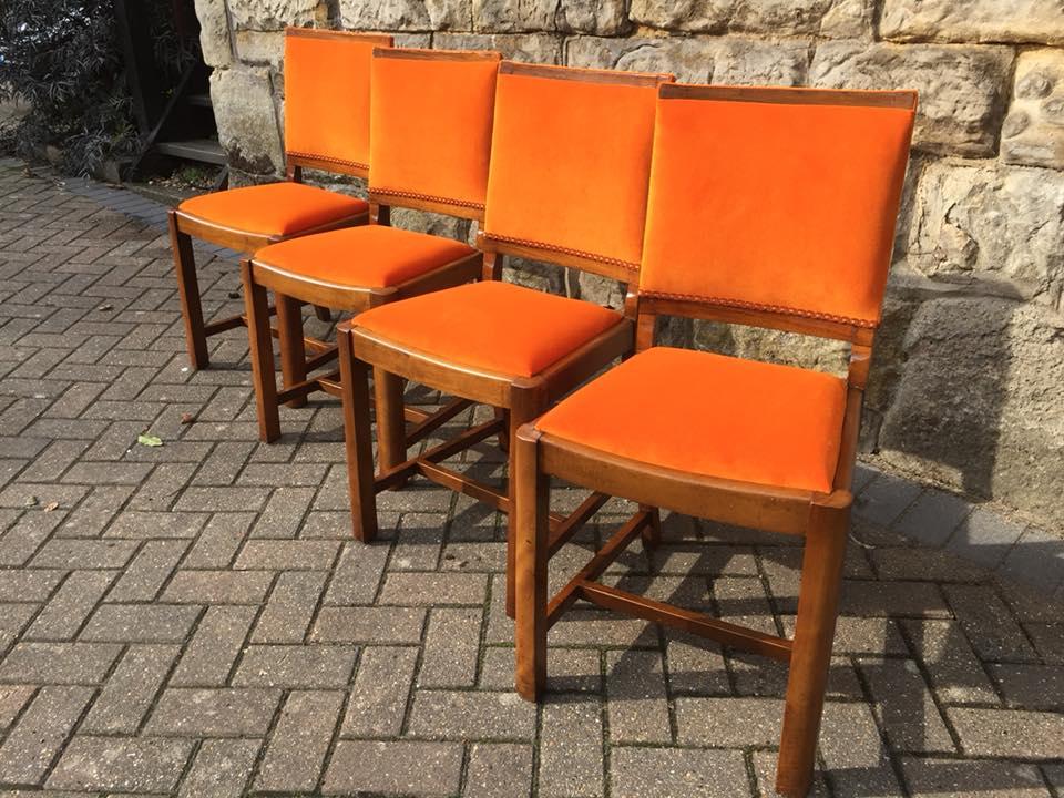 Set of orange dining chairs