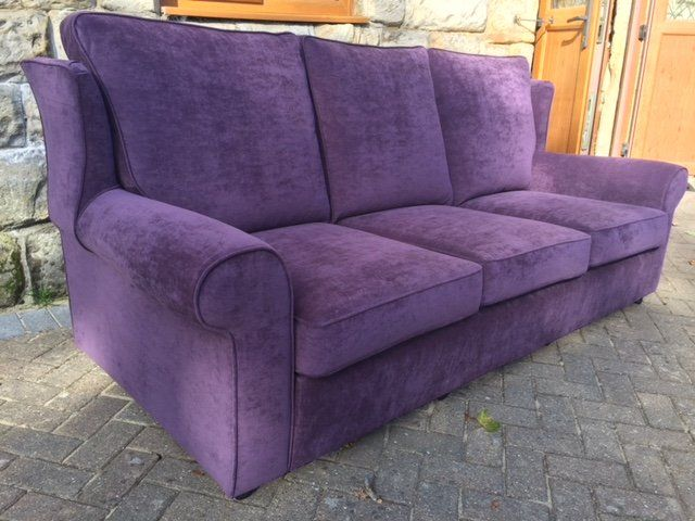 Plum coloured sofa