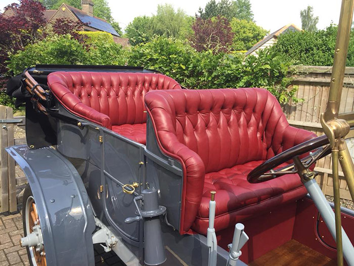 Red seats in an antique car