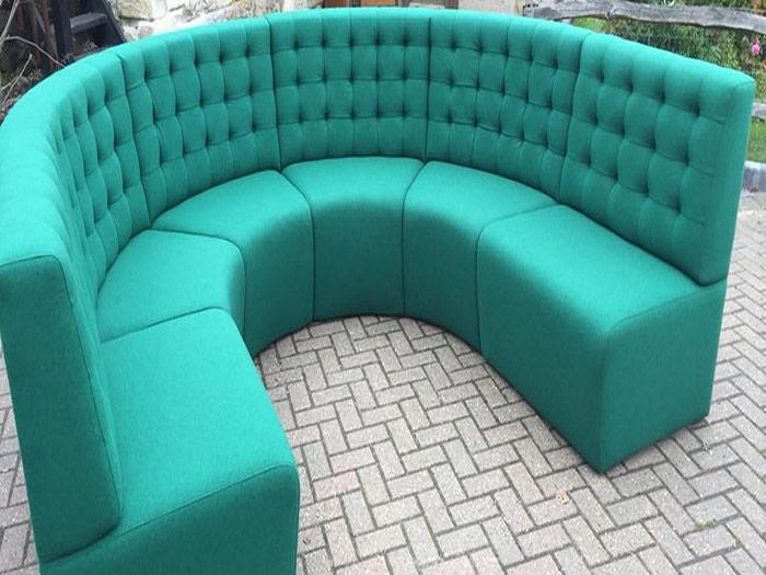 Large round turquoise sofa